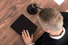 Judge With Gavel And Book Royalty Free Stock Images