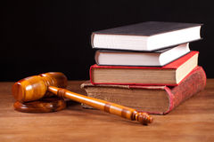 Judge gavel and books. Judge gavel and law books  on table with black background Royalty Free Stock Photos