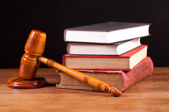 Judge gavel and books. Judge gavel and law books  on table with black background Stock Images