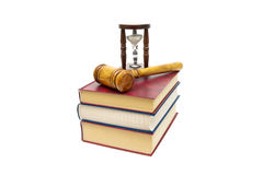 Judge gavel, books and hourglass isolated on a white background Stock Photography