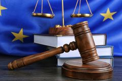Judge gavel and books with scales on European Union Royalty Free Stock Photos