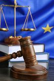 Judge gavel and books with scales on European Union Royalty Free Stock Photo