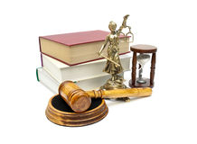 Judge gavel, books and a statue of justice on a white background Royalty Free Stock Photography