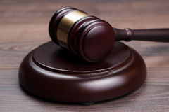 Judge gavel on brown wooden table Stock Photo