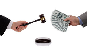 Judge with gavel and businessman with money