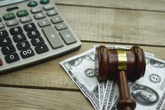 Judge gavel, calculator and money on wooden table. Close up royalty free stock photos