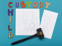 Judge gavel and colourful letters regarding child custody, family law concept. Royalty Free Stock Images