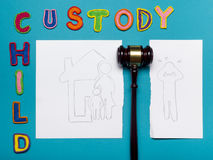 Judge gavel and colourful letters regarding child custody, family law concept. Royalty Free Stock Image