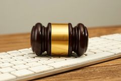 Judge gavel on computer keyboard. Royalty Free Stock Images