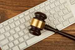 Judge gavel on computer keyboard. Royalty Free Stock Photo