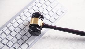 Judge gavel with computer keyboard. Concept of internet crime royalty free stock photo