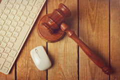 Judge gavel and computer keyboard on wooden vintage background Stock Photos