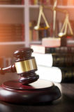 Judge gavel in court. Library with lot of books in background. Gavel in court room library. law attorney legal legality weight scales background gavel concept Stock Photos