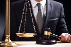 Judge gavel deciding on marriage divorce. Hands of judge, signing decree of divorce, dissolution, canceling marriage, legal separation documents stock photo