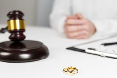 Judge gavel deciding on marriage divorce. Hands of judge, signing decree of divorce, dissolution, canceling marriage, legal separation documents, filing stock photos