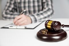 Judge gavel deciding on marriage divorce. Hands of judge, signing decree of divorce, dissolution, canceling marriage, legal separation documents, filing stock images