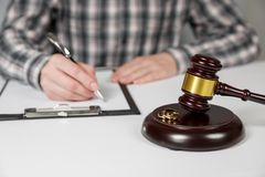 Judge gavel deciding on marriage divorce. Hands of judge, signing decree of divorce, dissolution, canceling marriage, legal separation documents, filing royalty free stock images