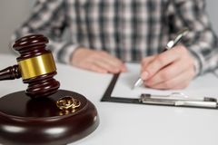 Judge gavel deciding on marriage divorce stock photography