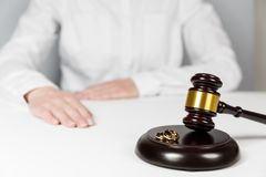 Judge gavel deciding on marriage divorce. Hands of judge, signing decree of divorce, dissolution, canceling marriage, legal separation documents, filing royalty free stock photos