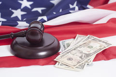 Judge gavel, Dollar banknotes and American flag Royalty Free Stock Photos