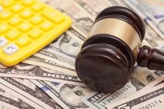 Judge gavel,dollar banknotes and calculators Stock Image