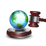 Judge gavel and earth globe Royalty Free Stock Photo