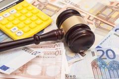 Judge gavel, euro banknotes and calculator Stock Photos
