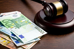 Judge gavel with euro bills Royalty Free Stock Image