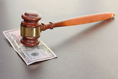 Judge gavel and fifty dollars banknote. Stock Photos