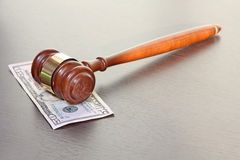Judge gavel with fifty dollars banknote on wooden table. Royalty Free Stock Images