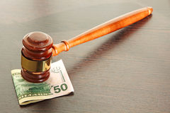 Judge gavel and fifty dollars on wooden table. Stock Images