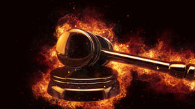 Judge gavel fire flames explosion burning explode Royalty Free Stock Photos