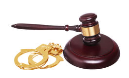 Judge gavel and gold handcuffs with money isolated Stock Images
