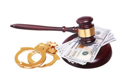 Judge gavel and gold handcuffs with money isolated on white Royalty Free Stock Photography