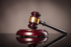 Judge gavel on grey studio background Royalty Free Stock Image