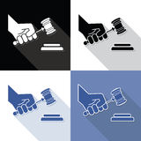 Judge gavel in hand symbols Royalty Free Stock Photography