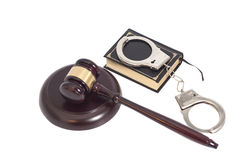 Judge gavel,Handcuffs and book on law isolated on white backgrou Royalty Free Stock Photo