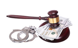 Judge gavel and handcuffs with money isolated on white backgroun Stock Photo