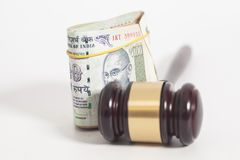 Judge gavel and Indian Currency Rupee bank notes on white Stock Image