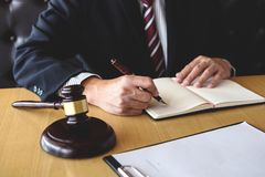 Judge gavel with Justice lawyers, Businessman in suit or lawyer. Working on a documents. Legal law, advice and justice concept Royalty Free Stock Photo