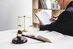 Judge gavel with Justice lawyers, Businessman in suit or lawyer. Working on a documents. Legal law, advice and justice concept royalty free stock photos