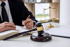 Judge gavel with Justice lawyers, Businessman in suit or lawyer. Working on a documents. Legal law, advice and justice concept stock photos