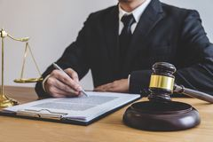 Judge gavel with Justice lawyers, counselor in suit or lawyer working on a documents at law firm in office. Legal law, advice and. Justice concept royalty free stock image