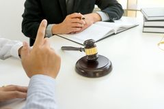 Judge gavel with Justice lawyers having team meeting. At law firm in background. Concepts of law or Auction Stock Image