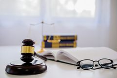 Judge gavel with Justice lawyers having team meeting at law firm. In background. Concepts of law royalty free stock photo