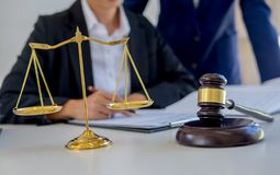 Judge gavel with Justice lawyers having team meeting at law firm stock image