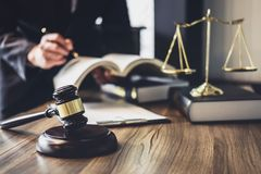 Judge gavel with Justice lawyers, Lawyer or Judge counselor work. Ing with agreement contract in Courtroom, Justice and Law concept royalty free stock photo
