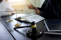 Judge gavel with Justice lawyers Plaintiff or defendant meeting. At law firm in background. Concept of law royalty free stock photos