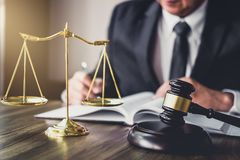 Judge gavel with Justice lawyers, Gavel on wooden table and Counselor or Male lawyer working on a documents. Legal law, advice. And justice concept stock images