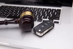 Judge gavel on laptop keyboard. Symbol of law, justice and online auction royalty free stock image